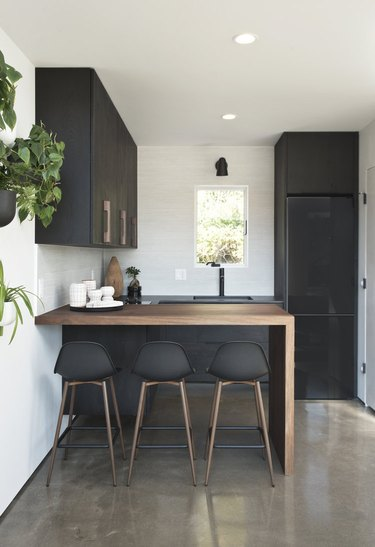 Wood Waterfall Countertop in Kitchen by Dichotomy Interiors