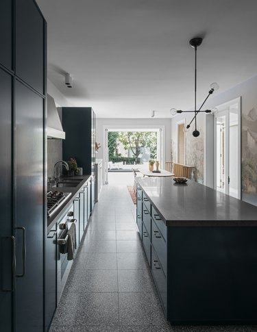 Blue cabinets and gray countertops