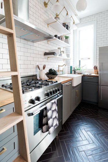 modern kitchen with white subway tile walls and ceramic tile flooring