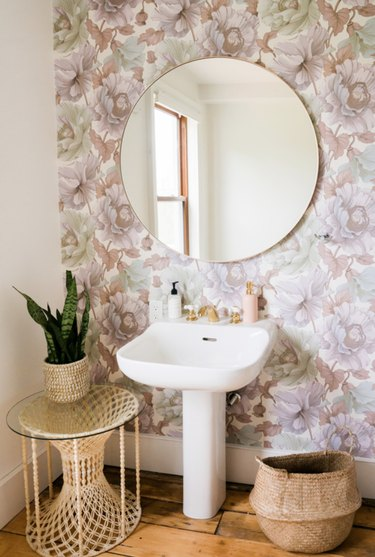A patch of wallpaper turns a blah bathroom into something special.