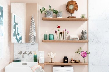 Floating shelves around your sink provide easy access to all your self-care needs.