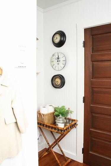 three antique clocks on a wall
