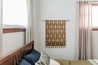 textile wall hanging in bedroom