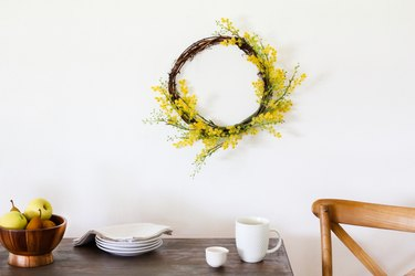 yellow wreath above table