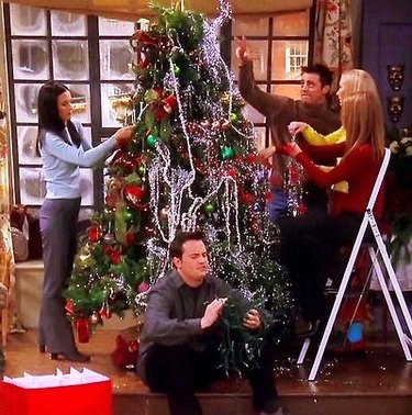 scene from Friends show with figures decorating a Christmas tree