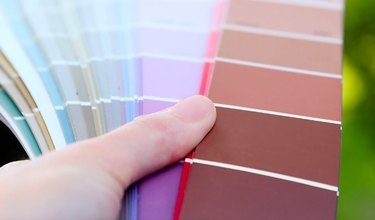 Studying paint chips.