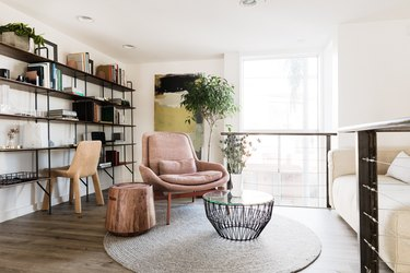 Hunker house bookshelves, pick chair and accent tables