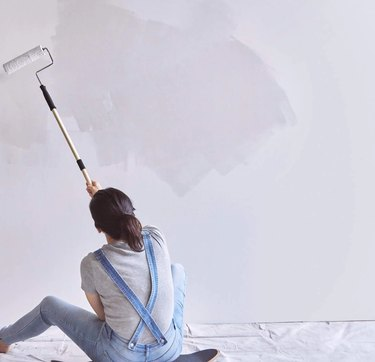 backdrop west coast ghost paint color, still image of woman painting wall on skateboard