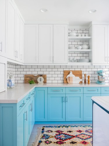 bright blue and white kitchen with white upper cabinets