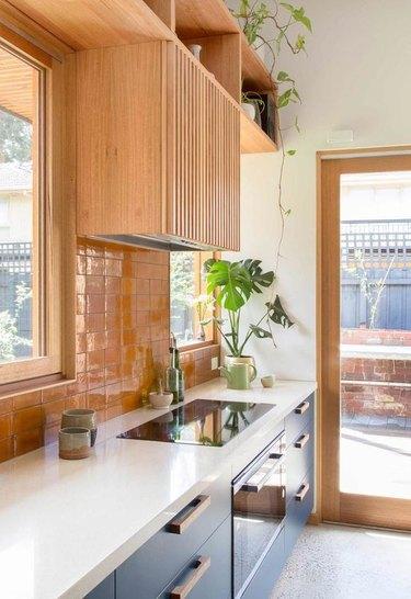 orange kitchen color idea with wood kitchen with orange backsplash