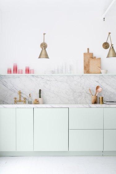 mint green kitchen with marble backsplash