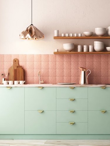 mint green kitchen with rose gold backsplash and open shelving