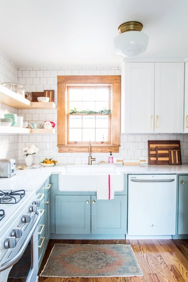 country style mint green kitchen with open shelving and subway tile backsplash