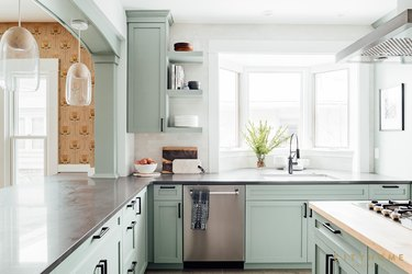 mint green kitchen with retro brown wallpaper