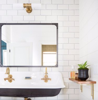 Simple and classic white subway tile partnered with a troughs sink is a match made in heaven.