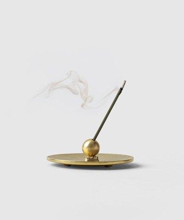 incense in brass holder