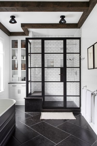 small industrial bathroom with metal shower doors