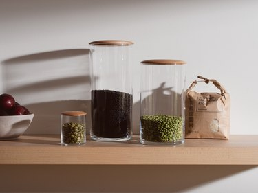 clear containers on wooden shelf