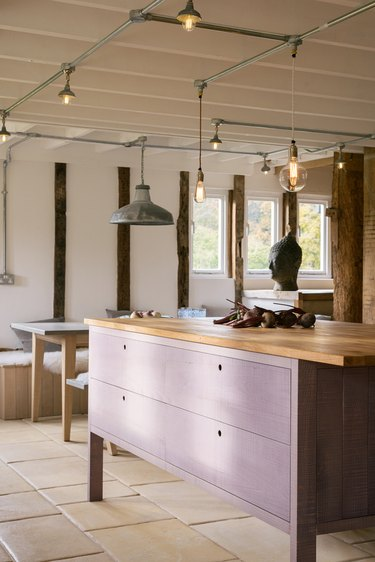 purple kitchen color idea with wood countertops and tile flooring