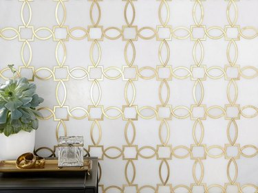 Brass inlay on marble tile