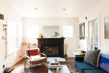 Black fireplace in a sunny white Craftsman style living room