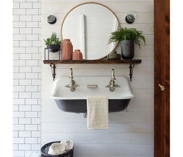 Farmhouse sink with a rustic wood shelf under a Target Project 62 round shelf.