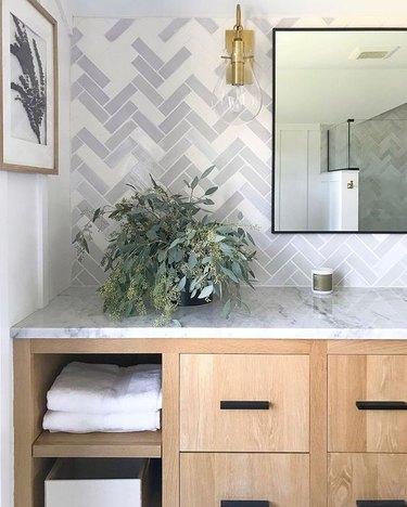 mosaic tile bathroom backsplash idea with gray and white herringbone tile