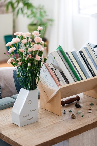 vase with flower and books nearby