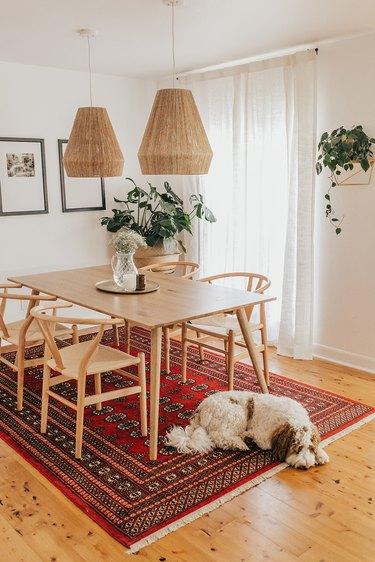 Scandinavian boho dining room with rattan pendants and Persian rug