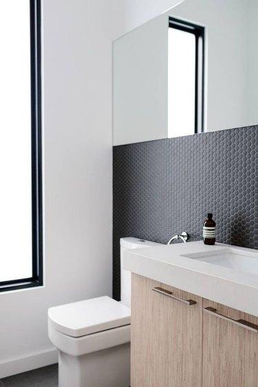 penny tile bathroom backsplash idea with black tile and black grout