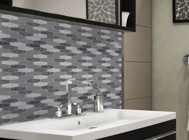 Gray and white peel and stick tiles in modern bathroom