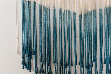 Re-dip the macrame into the bucket of dye to achieve an ombre effect.