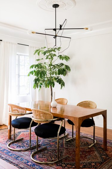 Cane cantilever chairs in a bohemian dining room