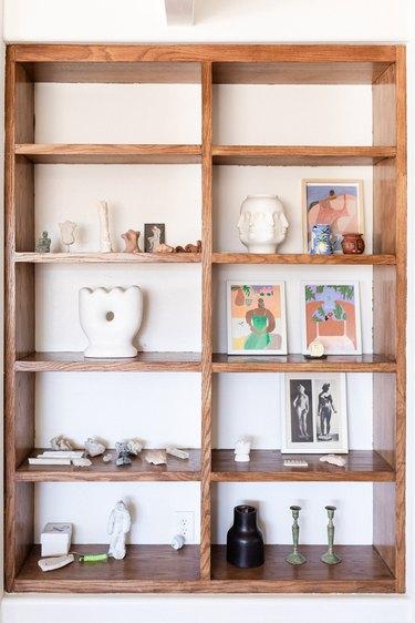 shelves with artwork and ceramics