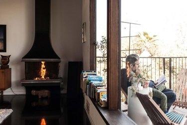 Black freestanding fireplace in modern living room