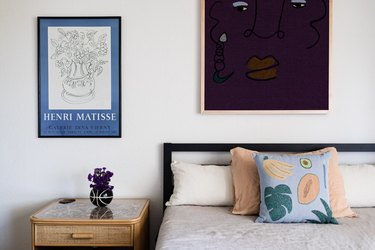 bedroom with framed artwork on the walls