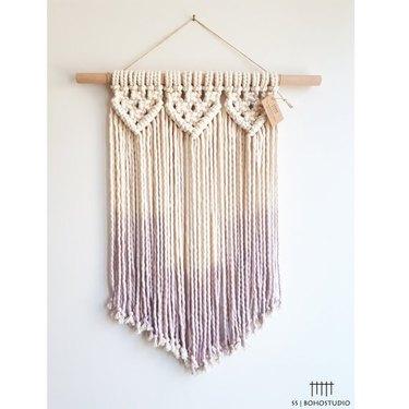 Dip-dyed woven wall hanging. Top half is beige, bottom half is lavender