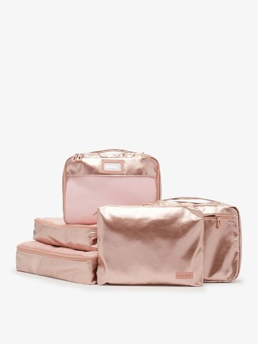 Rose gold metallic packing cubes in five different shapes/sizes