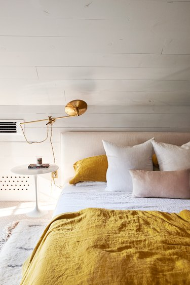 bedroom with yellow and pink bedding