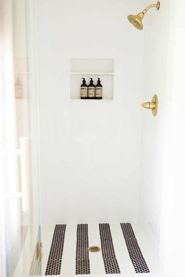 Striped floor in the shower