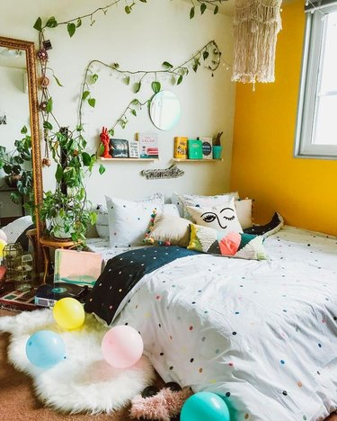 bohemian bedroom with yellow accent wall