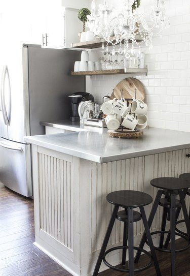 white kitchen with. stainless steel countertops