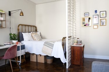 small bedroom idea with brass bed and plantation shutters.