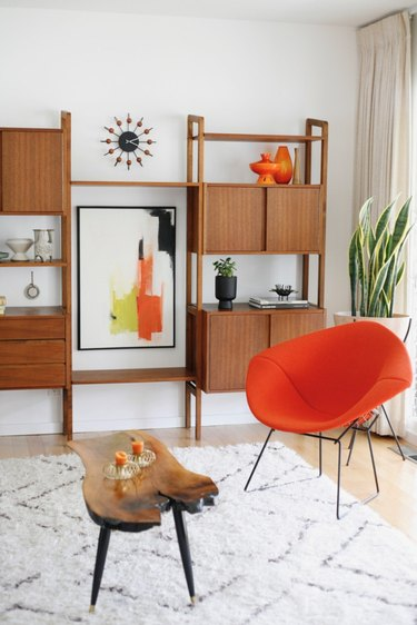 Orange and white midcentury modern colors in den