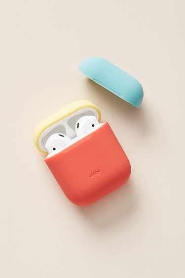 Color-blocked Airpod case. Colors: Orange, yellow, turquoise