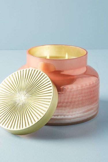 Large peach metallic candle with gold top