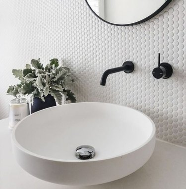penny tile bathroom backsplash idea with gray tile and white grout