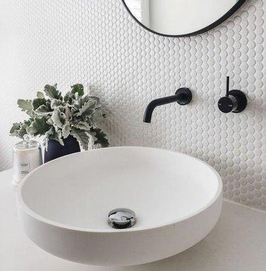 Round bowl sink, black Wall-Mounted Bathroom Faucet, hectagonal backsplash.