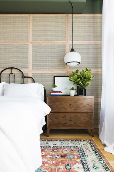 art deco bedroom with cane accent wall and hanging pendant lights