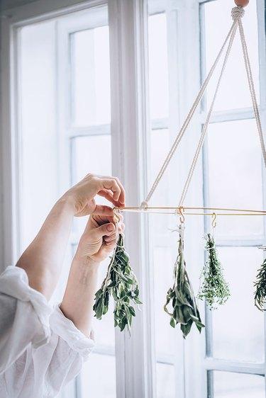 Attaching herbs to DIY Herb Drying Rack